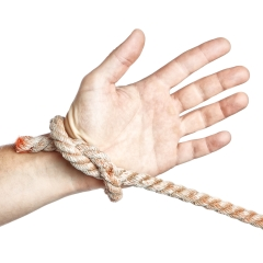 Man's hand tied  limitation with a rope. On a white background.