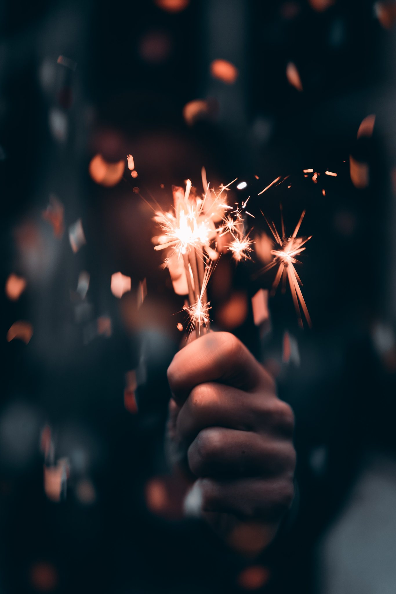 person-holding-a-sparkler-in-macro-photography-3264533
